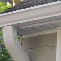 Aluminum eavestrough gutter installation with downspout